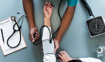 a nurse checking blood pressure