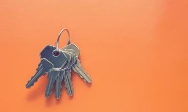 House keys on an orange background