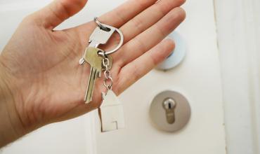 a hand holding a house key
