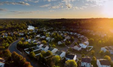 Aerial view of a suburban neighborhood at dusk