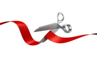 a red ribbon with scissors