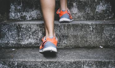 feet running up a flight of stairs