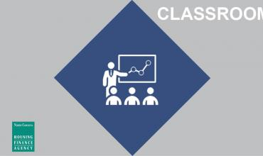 White outline of a classroom in a navy blue diamond graphic