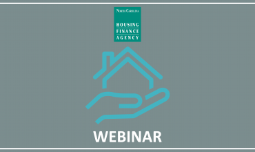 Blue outline of hand holding a house with WEBINAR written below