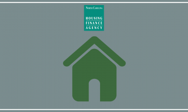 Green house graphic against gray background with the Agency's logo above it