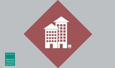 Gray graphic with red diamond and white apartments in center