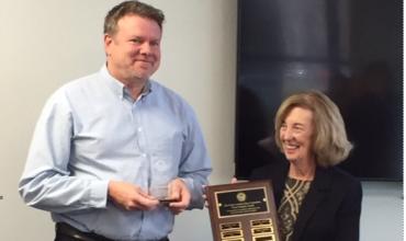 Sim Hodges receiving an award
