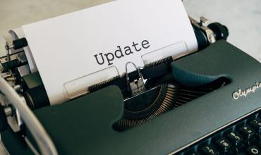 Typewriter with paper that says Update on it