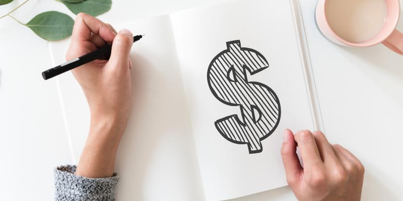 a notebook with a dollar sign drawn in marker