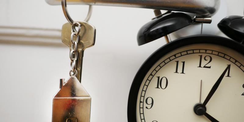 A clock, a key and a door handle