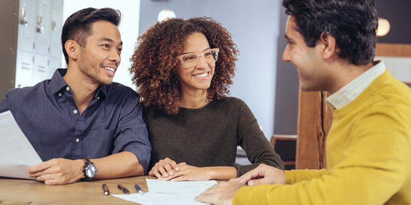 Home buyers sitting at a table with a lender