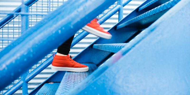 orange shoes on a blue staircase