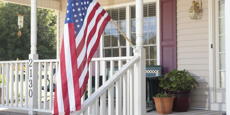 an American flag on a front porch