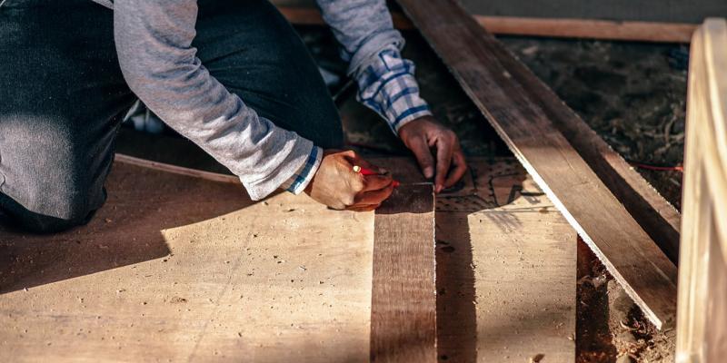 a man measuring wood