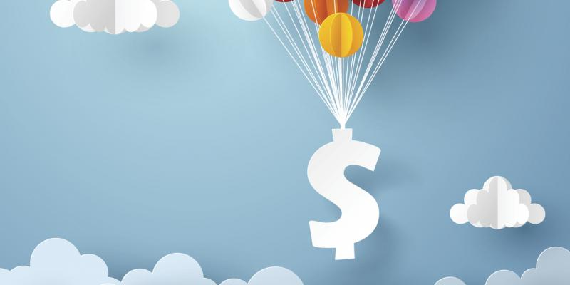 A dollar sign floating with multicolored balloons