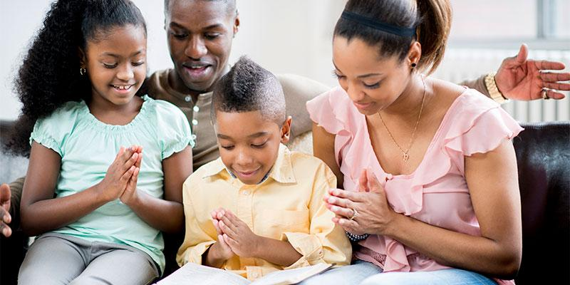 family of four reading together