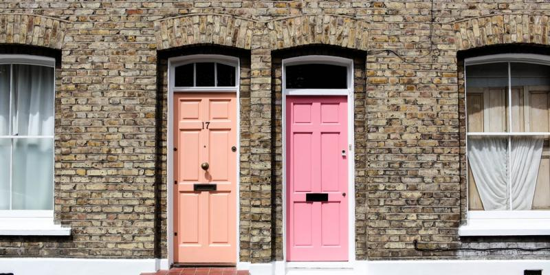 a coral door and a pink door side by side