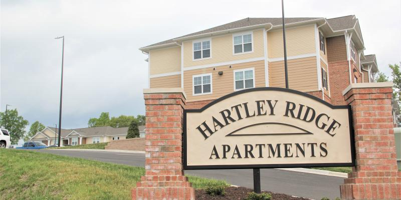 Photo of Hartley Ridge Apartments sign with building in the background