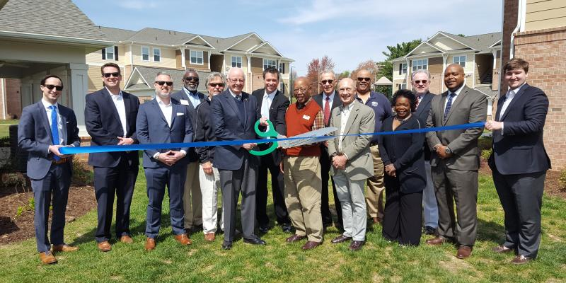 attendees cutting a ribbon at Kitkwood Crossing