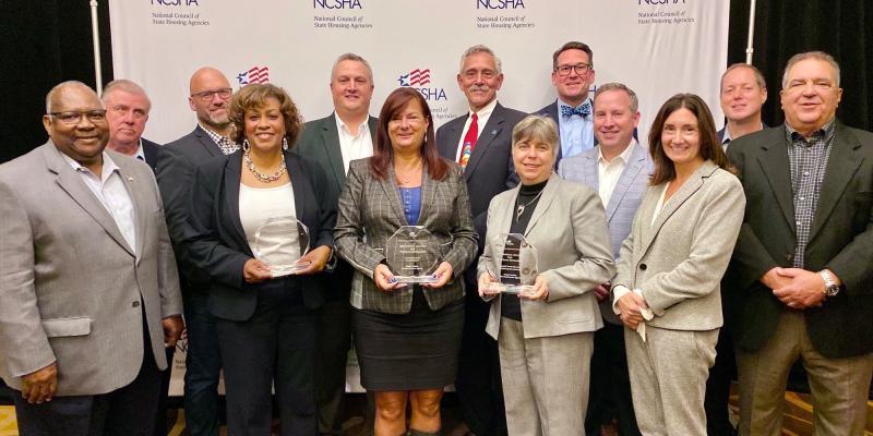 NCHFA staff holding their trophies