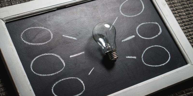 Lightbulb laying on a chalkboard